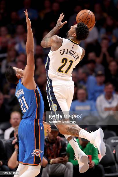 Wilson Chandler of the Denver Nuggets puts up a shot against Andre Roberson of the Oklahoma City Thunder at the Pepsi Center on October 10 2017 in...