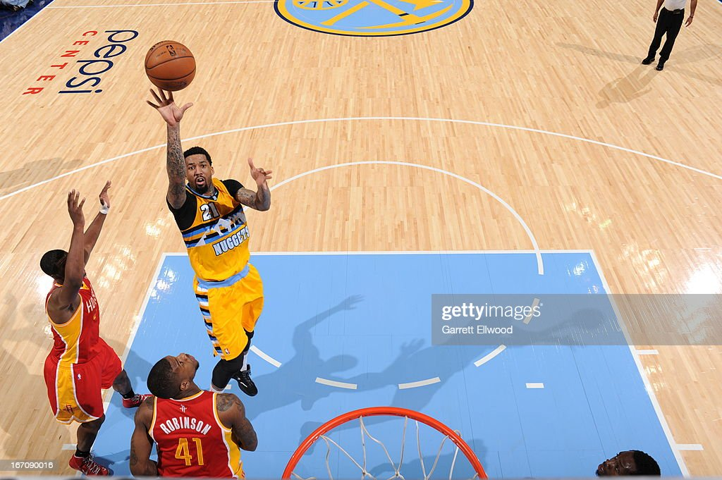 <a gi-track='captionPersonalityLinkClicked' href=/galleries/search?phrase=Wilson+Chandler&family=editorial&specificpeople=809324 ng-click='$event.stopPropagation()'>Wilson Chandler</a> #21 of the Denver Nuggets puts up a shot against the Houston Rockets on April 6, 2013 at the Pepsi Center in Denver, Colorado.