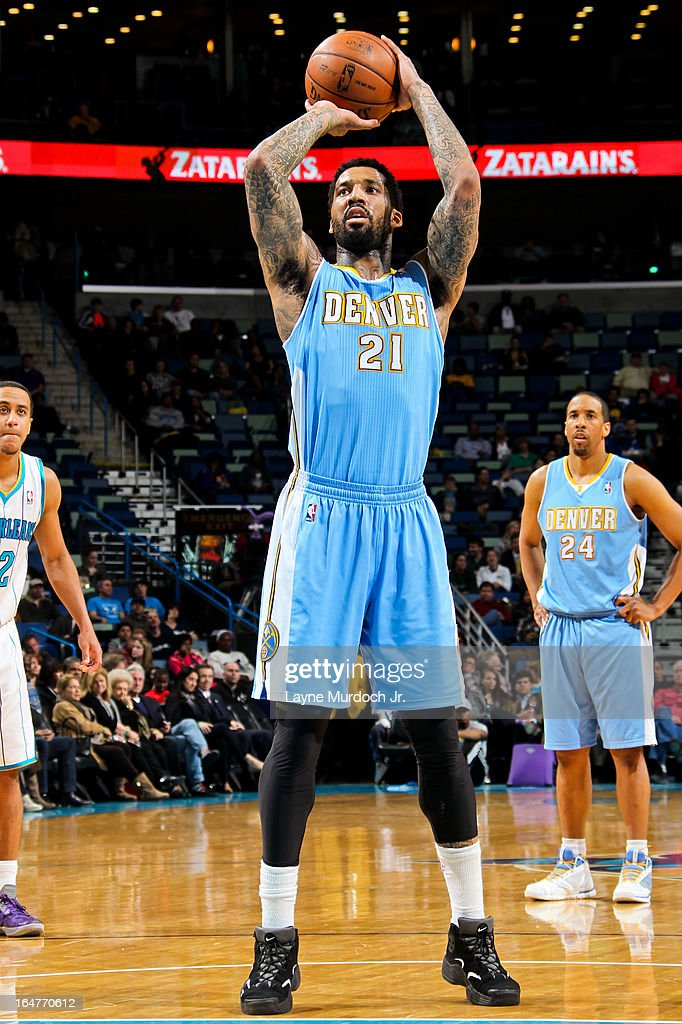 <a gi-track='captionPersonalityLinkClicked' href=/galleries/search?phrase=Wilson+Chandler&family=editorial&specificpeople=809324 ng-click='$event.stopPropagation()'>Wilson Chandler</a> #21 of the Denver Nuggets shoots a free-throw against the New Orleans Hornets on March 25, 2013 at the New Orleans Arena in New Orleans, Louisiana.