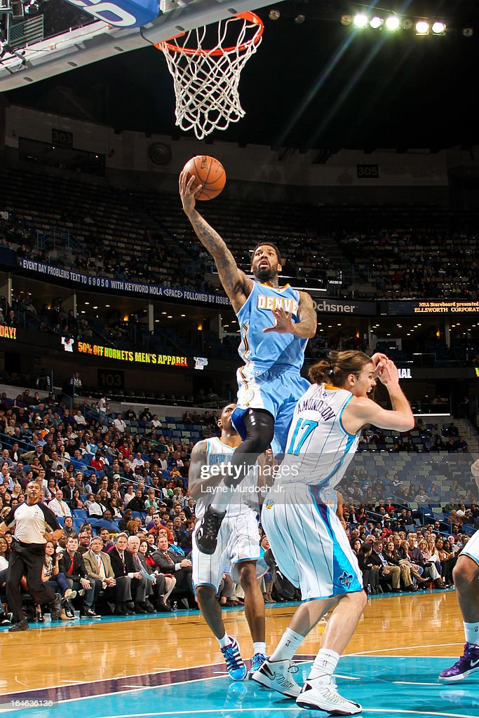 Wilson Chandler #21 of the Denver Nuggets shoots a layup against Lou Amundson #17 of the New Orleans Hornets on March 25, 2013 at the New Orleans Arena in New Orleans, Louisiana.