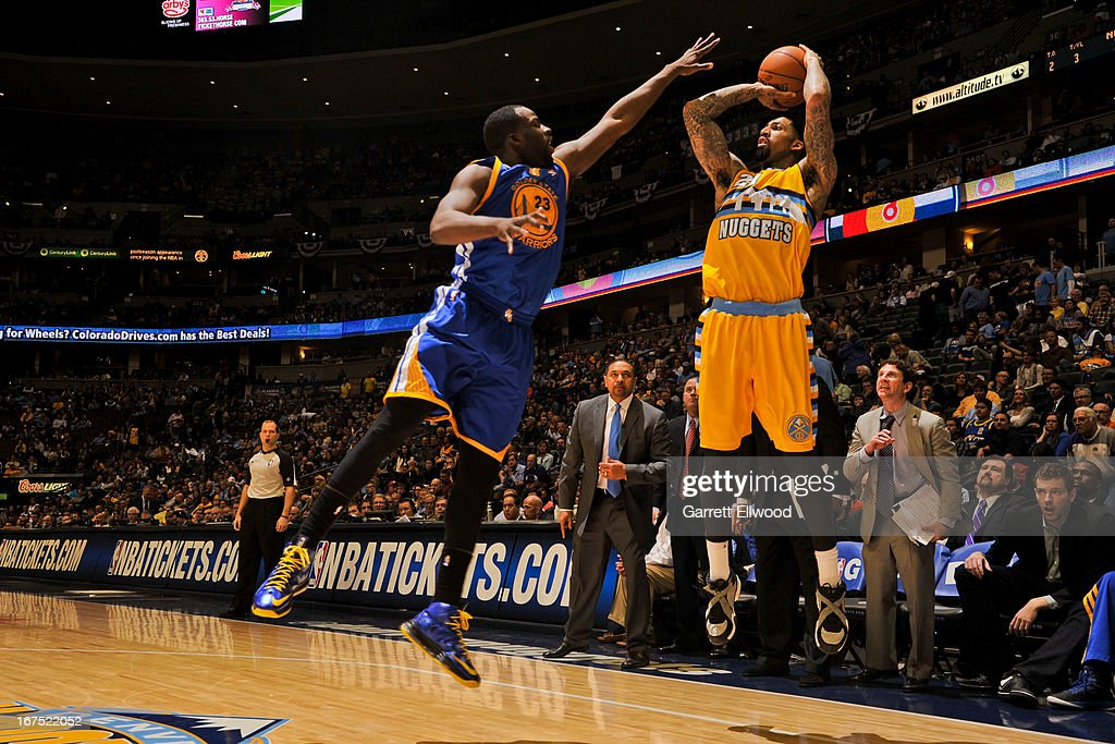 Wilson Chandler #21 of the Denver Nuggets shoots a three-pointer against Draymond Green #23 of the Golden State Warriors in Game Two of the Western Conference Quarterfinals during the 2013 NBA Playoffs on April 23, 2013 at the Pepsi Center in Denver, Colorado.