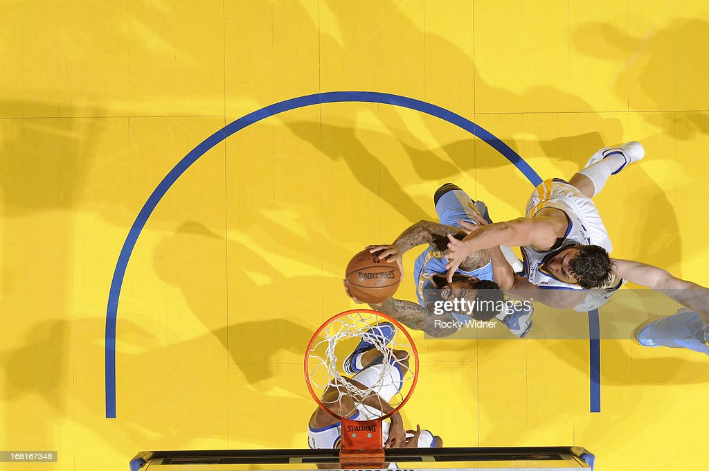 <a gi-track='captionPersonalityLinkClicked' href=/galleries/search?phrase=Wilson+Chandler&family=editorial&specificpeople=809324 ng-click='$event.stopPropagation()'>Wilson Chandler</a> #21 of the Denver Nuggets shoots against <a gi-track='captionPersonalityLinkClicked' href=/galleries/search?phrase=Andrew+Bogut&family=editorial&specificpeople=207105 ng-click='$event.stopPropagation()'>Andrew Bogut</a> #12 of the Golden State Warriors in Game Six of the Western Conference Quarterfinals during the 2013 NBA Playoffs on May 2, 2013 at Oracle Arena in Oakland, California.