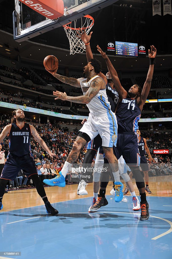 <a gi-track='captionPersonalityLinkClicked' href=/galleries/search?phrase=Wilson+Chandler&family=editorial&specificpeople=809324 ng-click='$event.stopPropagation()'>Wilson Chandler</a> #21 of the Denver Nuggets shoots against the Charlotte Bobcats on January 29, 2014 at the Pepsi Center in Denver, Colorado.