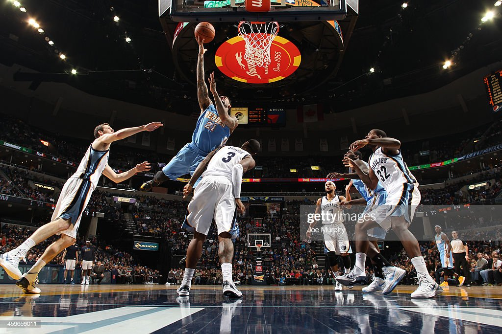 <a gi-track='captionPersonalityLinkClicked' href=/galleries/search?phrase=Wilson+Chandler&family=editorial&specificpeople=809324 ng-click='$event.stopPropagation()'>Wilson Chandler</a> #21 of the Denver Nuggets shoots against the Memphis Grizzlies on December 28, 2013 at FedExForum in Memphis, Tennessee.