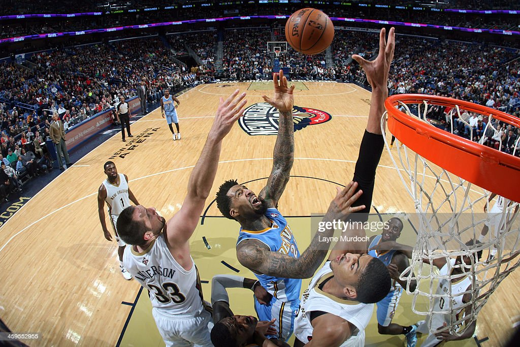 <a gi-track='captionPersonalityLinkClicked' href=/galleries/search?phrase=Wilson+Chandler&family=editorial&specificpeople=809324 ng-click='$event.stopPropagation()'>Wilson Chandler</a> #21 of the Denver Nuggets shoots against the New Orleans Pelicans on December 27, 2013 at the New Orleans Arena in New Orleans, Louisiana.