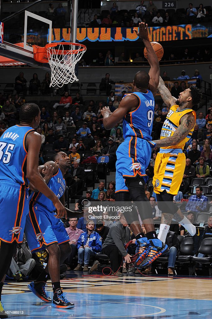 <a gi-track='captionPersonalityLinkClicked' href=/galleries/search?phrase=Wilson+Chandler&family=editorial&specificpeople=809324 ng-click='$event.stopPropagation()'>Wilson Chandler</a> #21 of the Denver Nuggets shoots against the Oklahoma City Thunder on December 17, 2013 at the Pepsi Center in Denver, Colorado.