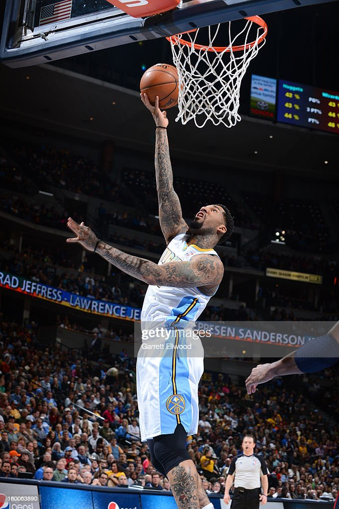 Wilson Chandler #21 of the Denver Nuggets shoots against the Washington Wizards on January 18, 2013 at the Pepsi Center in Denver, Colorado.