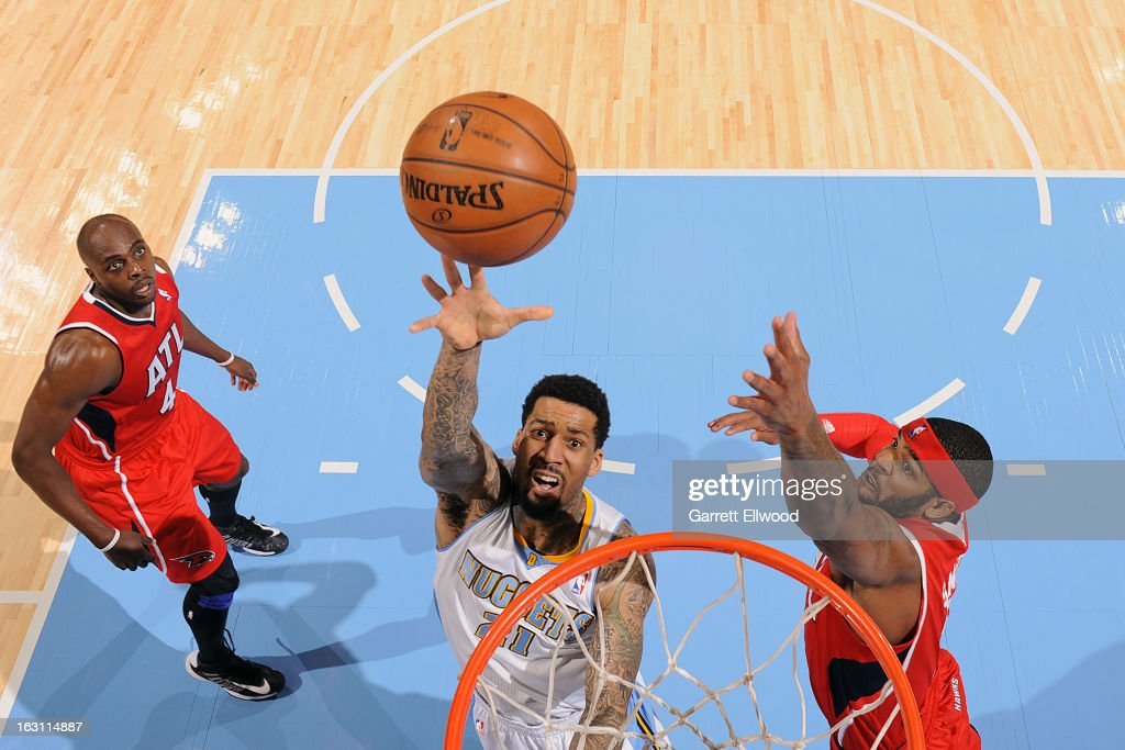 Wilson Chandler #21 of the Denver Nuggets shoots in the lane against Josh Smith #5 of the Atlanta Hawks on March 4, 2013 at the Pepsi Center in Denver, Colorado.
