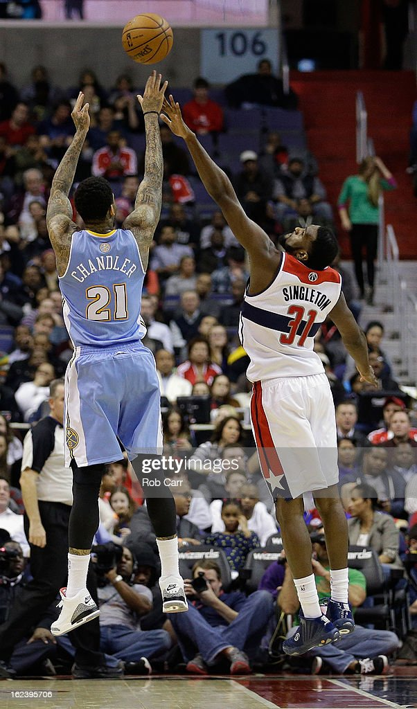 <a gi-track='captionPersonalityLinkClicked' href=/galleries/search?phrase=Wilson+Chandler&family=editorial&specificpeople=809324 ng-click='$event.stopPropagation()'>Wilson Chandler</a> #21 of the Denver Nuggets shoots over <a gi-track='captionPersonalityLinkClicked' href=/galleries/search?phrase=Chris+Singleton&family=editorial&specificpeople=241555 ng-click='$event.stopPropagation()'>Chris Singleton</a> #31 of the Washington Wizards during the second hafl at Verizon Center on February 22, 2013 in Washington, DC.