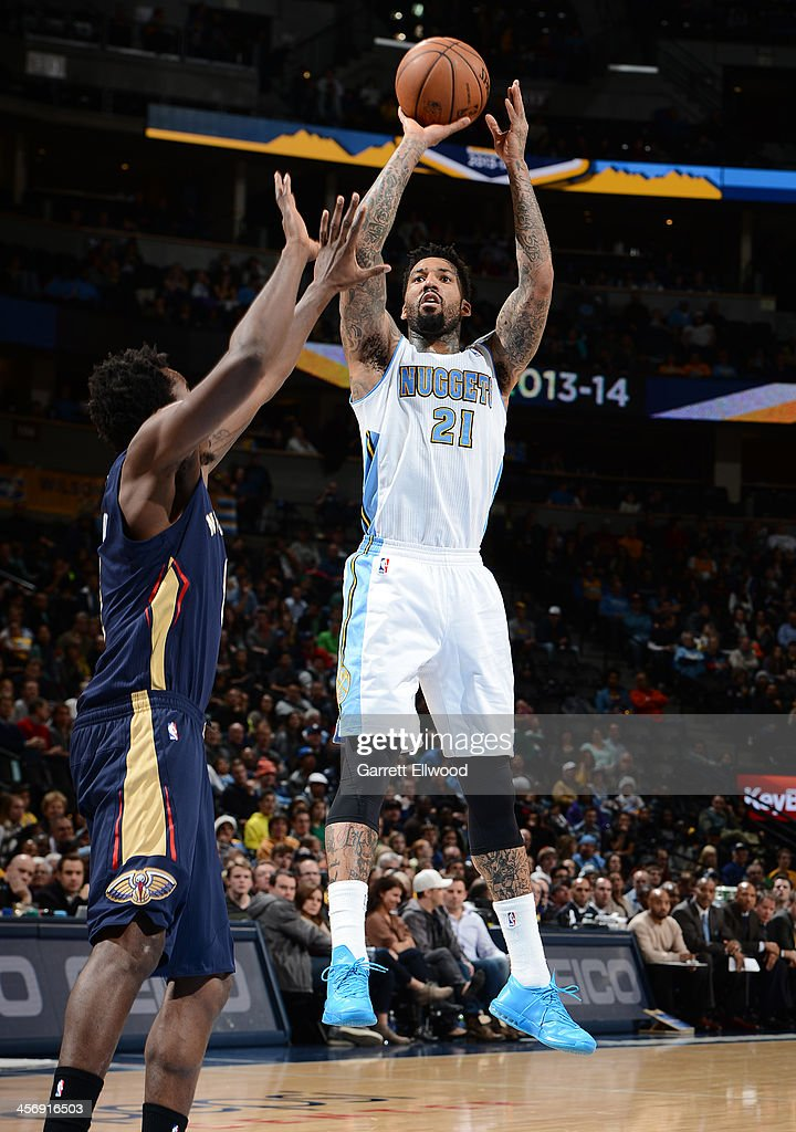 Wilson Chandler of the Denver Nuggets shoots the ball against the New Orleans Pelicans on December 15 2013 at the Pepsi Center in Denver Colorado...