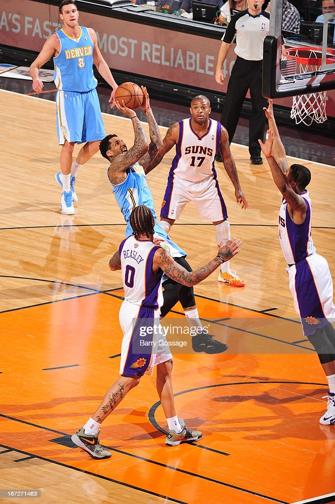 <a gi-track='captionPersonalityLinkClicked' href=/galleries/search?phrase=Wilson+Chandler&family=editorial&specificpeople=809324 ng-click='$event.stopPropagation()'>Wilson Chandler</a> #21 of the Denver Nuggets shoots the ball against the Phoenix Suns on March 11, 2013 at U.S. Airways Center in Phoenix, Arizona.