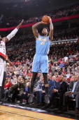 Wilson Chandler of the Denver Nuggets shoots the ball against the Portland Trail Blazers on January 23 2014 at the Moda Center Arena in Portland...