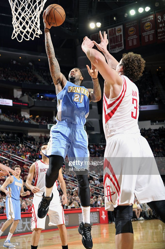 Wilson Chandler #21 of the Denver Nuggets shoots the ball over Omer Asik #3 of the Houston Rockets on January 23, 2013 at the Toyota Center in Houston, Texas.