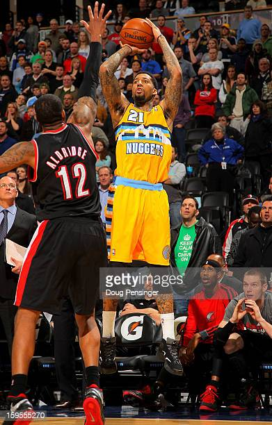Wilson Chandler of the Denver Nuggets sinks the game winning three point shot over LaMarcus Aldridge of the Portland Trail Blazers in overtime at the...