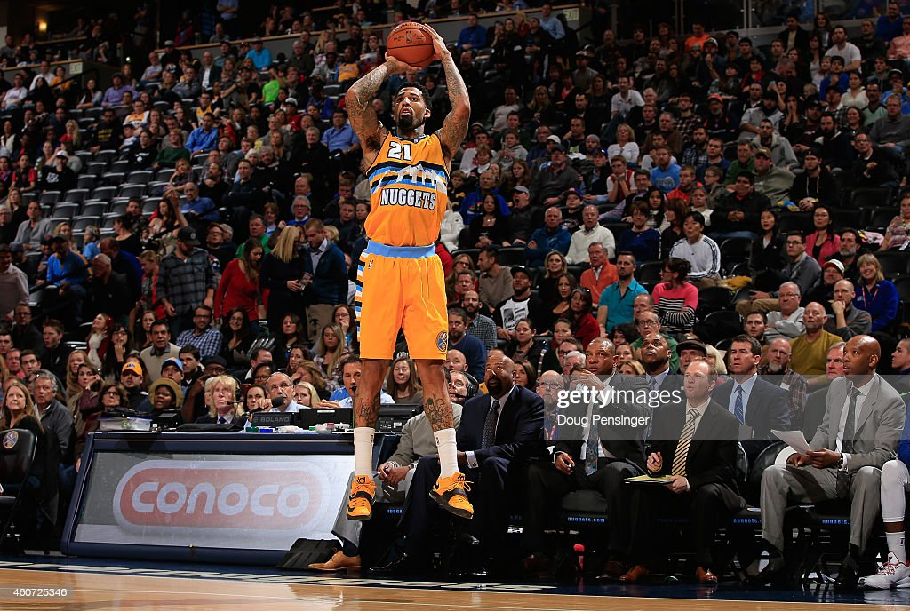 Wilson Chandler of the Denver Nuggets takes a shot against the Los Angeles Clippers at Pepsi Center on December 19 2014 in Denver Colorado The...