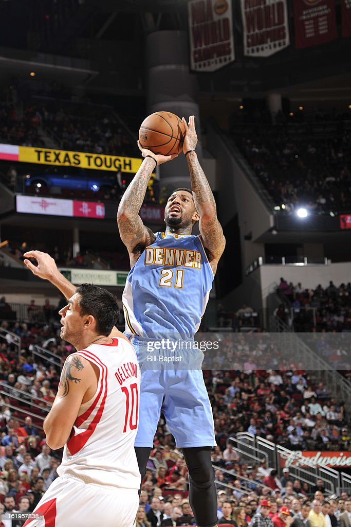 <a gi-track='captionPersonalityLinkClicked' href=/galleries/search?phrase=Wilson+Chandler&family=editorial&specificpeople=809324 ng-click='$event.stopPropagation()'>Wilson Chandler</a> #21 of the Denver Nuggets takes a shot against the Houston Rockets on January 23, 2013 at the Toyota Center in Houston, Texas.