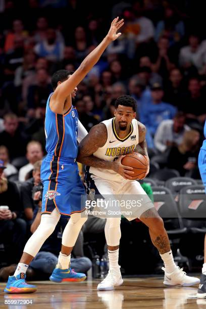 Wilson Chandler of the Denver Nuggets works towards the basket against Andre Roberson of the Oklahoma City Thunder at the Pepsi Center on October 10...