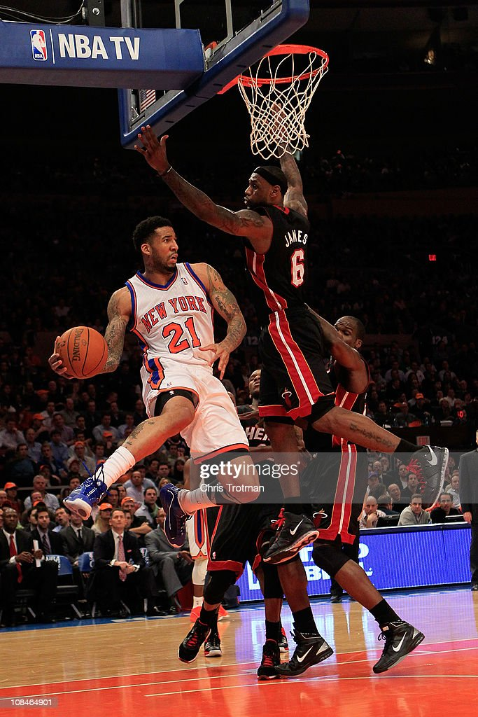 Wilson Chandler of the New York Knicks passes around LeBron James of the Miami Heat at Madison Square Garden on January 27 2011 in New York City NOTE...