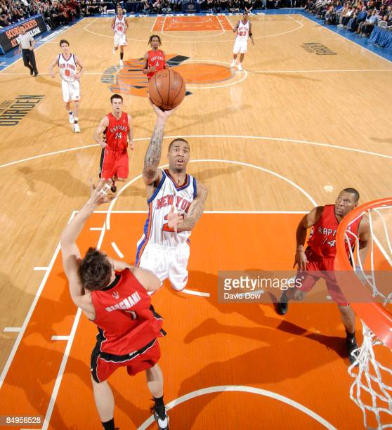 Wilson Chandler of the New York Knicks shoots against Andrea Bargnani of the Toronto Raptors on February 20 2009 at Madison Square Garden in New York...