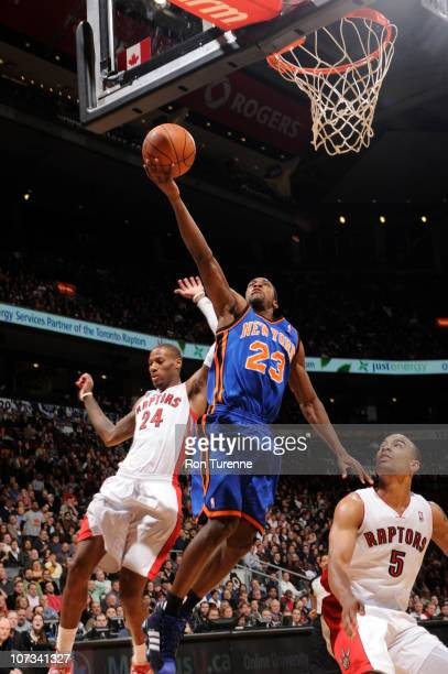 Wilson Chandler of the New York Knicks takes the layup over Jerryd Bayless of the Toronto Raptors during a game on December 5 2010 at the Air Canada...