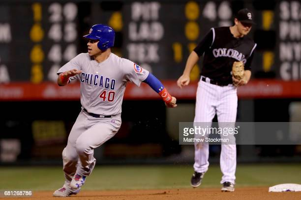 Wilson Contreras of the Chicago Cubs races to third base on a Jon Lay single in the eighth inning against the Colorado Rockies during the second game...