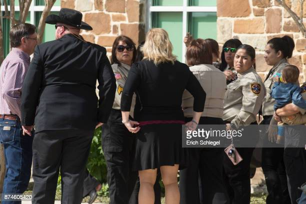 Wilson County Sheriff deputies arrive at the memorial service held at the Floresville Events Center on November 15 2017 in Floresville Texas for the...