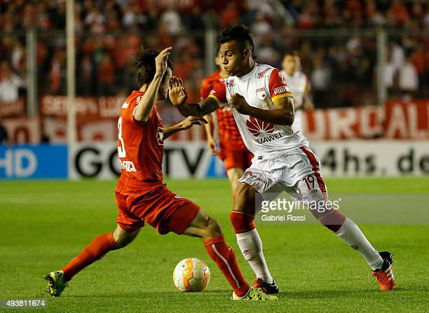 Wilson David Morelo of Independiente Santa Fe fights for the ball with Nicolas Tagliafico of Independiente during a match between Independiente and...