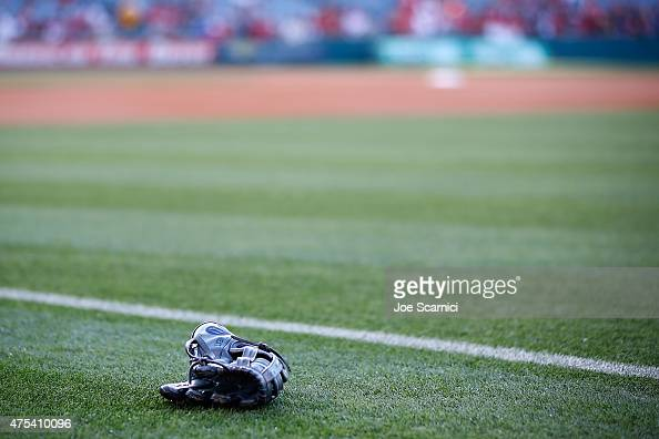 Wilson glove lays on the field prior to the game between the Detroit Tigers and the Los Angeles Angels at Angel Stadium of Anaheim on May 30 2015 in...