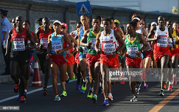 Wilson Kipsang Kiprotich of Kenya and Shumi Dechasa of Bahrain lead the pack in the Men's Marathon during day one of the 15th IAAF World Athletics...