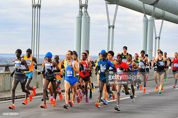 Wilson Kipsang leads a group of runners as they cross the VerrazanoNarrows Bridge at the start of the TCS New York City Marathon on November 2 2014...