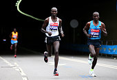 Wilson Kipsang of Kenya and Eliud Kipchoge of Kenya compete during the Virgin Money London Marathon on April 26 2015 in London England
