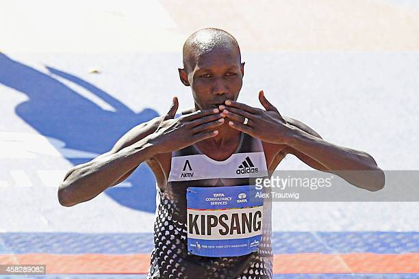 Wilson Kipsang of Kenya celebrates after crossing the finish line to win the Pro Men's division during the 2014 TCS New York City Marathon in Central...