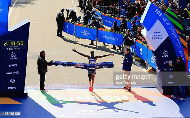 Wilson Kipsang of Kenya crosses the finish line to win the Pro Men's division during the 2014 TCS New York City Marathon in Central Park on November...