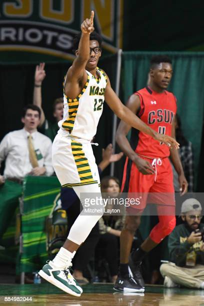 Wilson of the George Mason Patriots celebrates a basket during a college basketball tournament against the George Mason Patriots at the Eagle Bank...