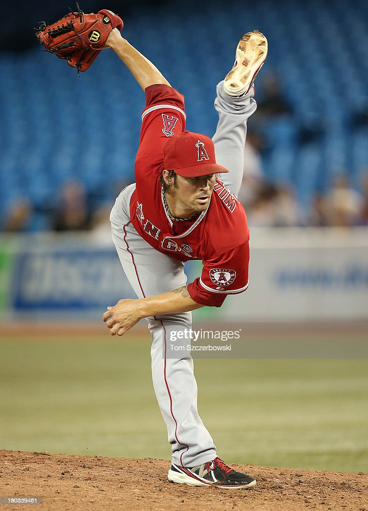 C.J. Wilson #33 of the Los Angeles Angels of Anaheim delivers a pitch in the third inning during MLB game action against the Toronto Blue Jays on September 11, 2013 at Rogers Centre in Toronto, Ontario, Canada.