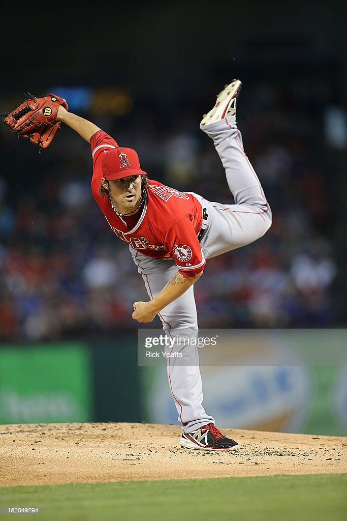 C.J. Wilson #33 of the Los Angeles Angels of Anaheim pitches in the first inning against the Texas Rangers at Rangers Ballpark in Arlington on September 27, 2013 in Arlington, Texas.