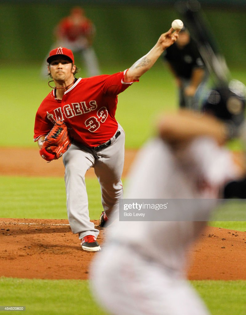C.J. Wilson #33 of the Los Angeles Angels of Anaheim throws in the first inning against the Houston Astros at Minute Maid Park on September 2, 2014 in Houston, Texas.