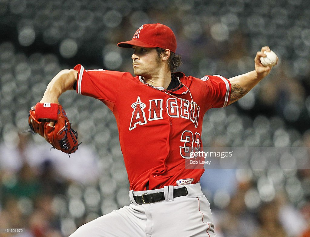 C.J. Wilson #33 of the Los Angeles Angels of Anaheim throws in the third inning against the Houston Astros at Minute Maid Park on September 2, 2014 in Houston, Texas.