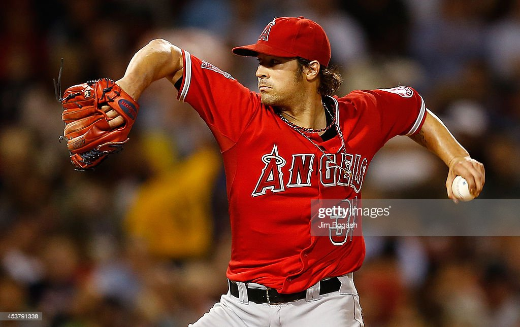 C.J. Wilson #33 of the Los Angeles Angels pitches in the fourth inning against the Boston Red Sox at Fenway Park on August 18, 2014 in Boston, Massachusetts.