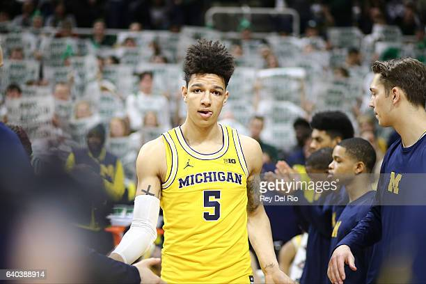 J Wilson of the Michigan Wolverines gets introduced into the starting lineup against the Michigan State Spartans at the Breslin Center on January 29...