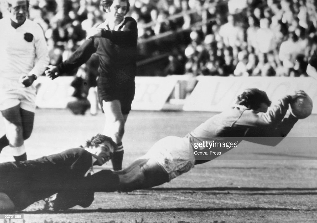 BW Wilson of the New Zealand All Blacks fails to stop DW Morgan of the British Lions from scoring a try during a rugby test match at Auckland New...