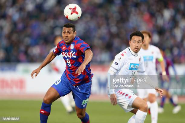 Wilson of Ventforet Kofu and Akito Fukumori of Consadole Sapporo compete for the ball during the JLeague J1 match between Ventforet Kofu and...