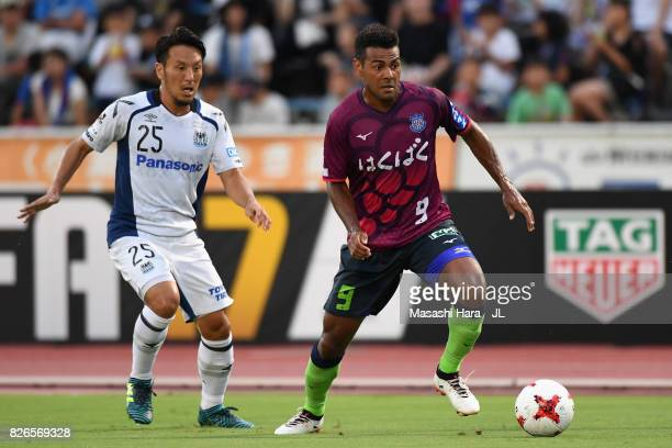 Wilson of Ventforet Kofu and Jungo Fujimoto of Gamba Osaka compete for the ball during the JLeague J1 match between Ventforet Kofu and Gamba Osaka at...