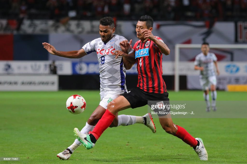 Wilson of Ventforet Kofu and Ryuji Kawai of Consadole Sapporo compete for the ball during the J.League J1 match between Consadole Sapporo and Ventforet Kofu at Sapporo Dome on August 13, 2017 in Sapporo, Hokkaido, Japan.