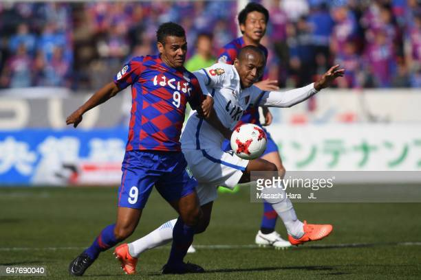 Wilson of Ventforet Kofu and Shoma Doi of Kashima Antlers compete for the ball during the JLeague J1 match between Ventforet Kofu and Kashima Antlers...