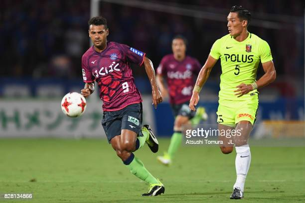 Wilson of Ventforet Kofu and Tomoaki Makino of Urawa Red Diamonds compete the ball during the JLeague J1 match between Ventforet Kofu and Urawa Red...