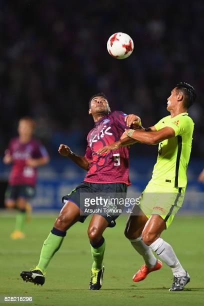 Wilson of Ventforet Kofu and Tomoaki Makino of Urawa Red Diamonds compete for the ball during the JLeague J1 match between Ventforet Kofu and Urawa...