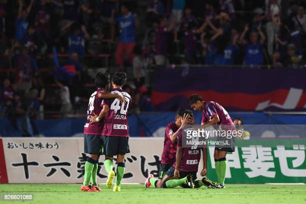 Wilson of Ventforet Kofu celebrates scoring his side's first goal with his team mates during the JLeague J1 match between Ventforet Kofu and Gamba...