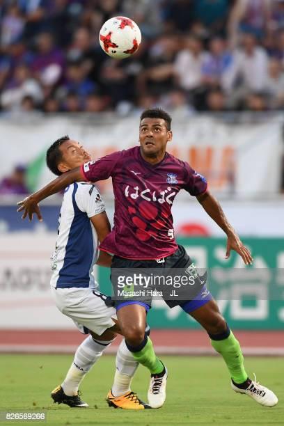 Wilson of Ventforet Kofu controls the ball under pressure of Yosuke Ideguchi of Gamba Osaka during the JLeague J1 match between Ventforet Kofu and...