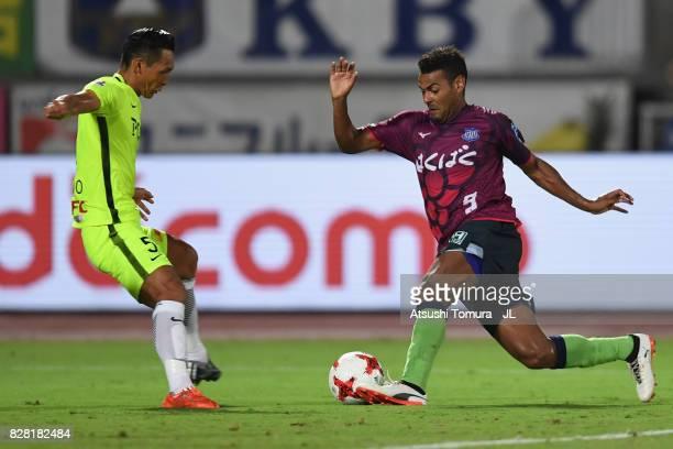 Wilson of Ventforet Kofu takes on Tomoaki Makino of Urawa Red Diamonds during the JLeague J1 match between Ventforet Kofu and Urawa Red Diamonds at...